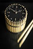 clock-drum-sticks
